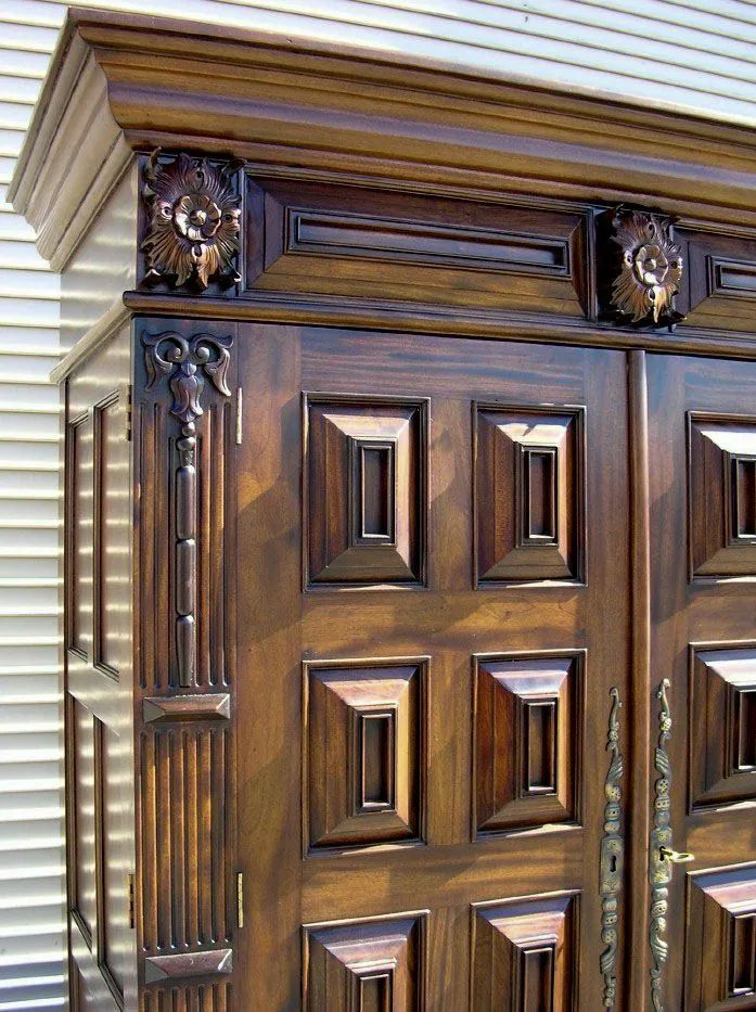 Raised panels detail on the front doors of Dutch Flanders paneled armoire