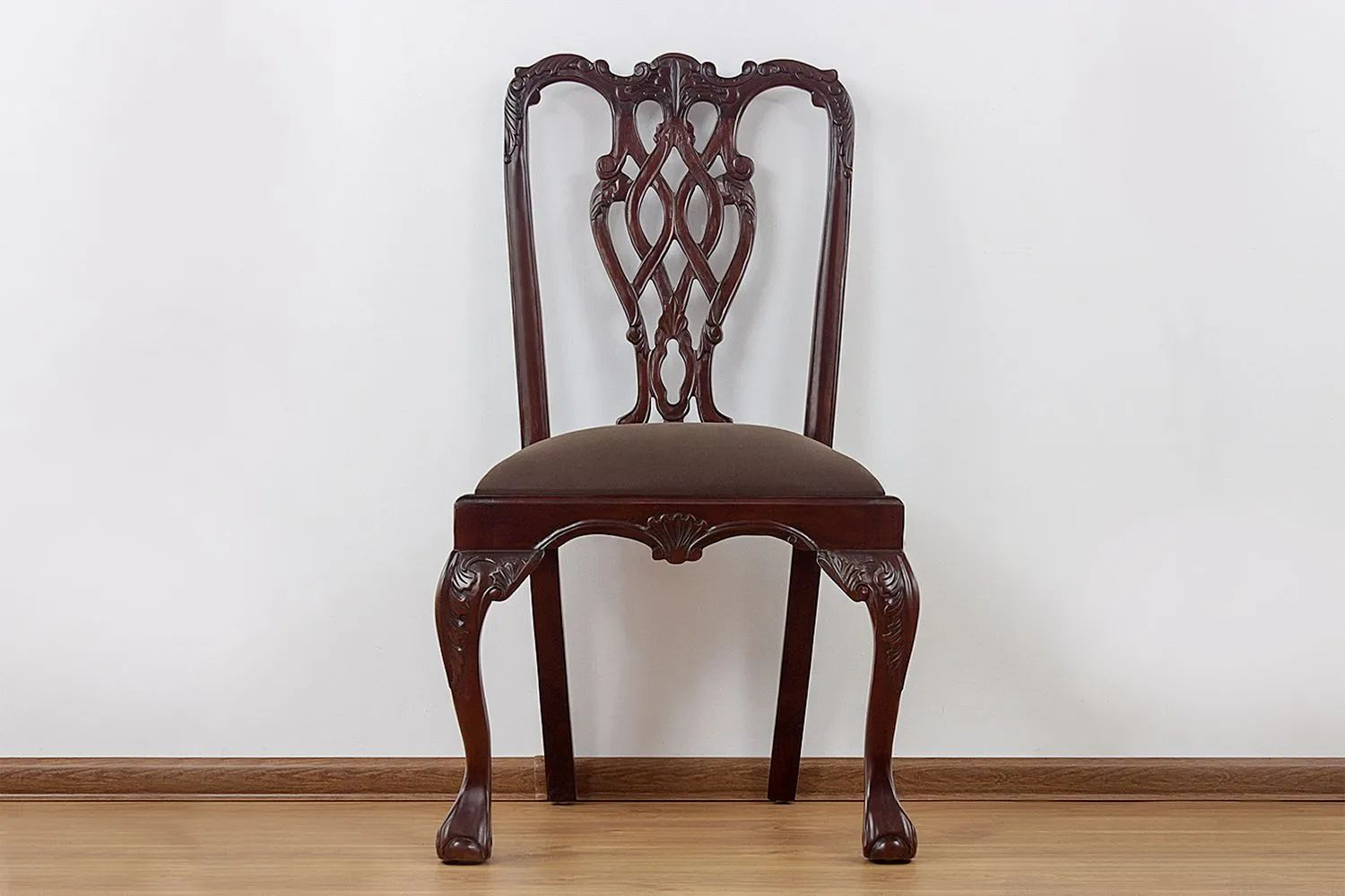Front side detailed view of the Chippendale ribbon backrest dining chair