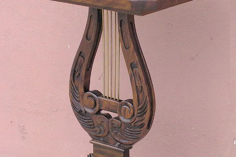 Mahogany wood carving and solid brass strings