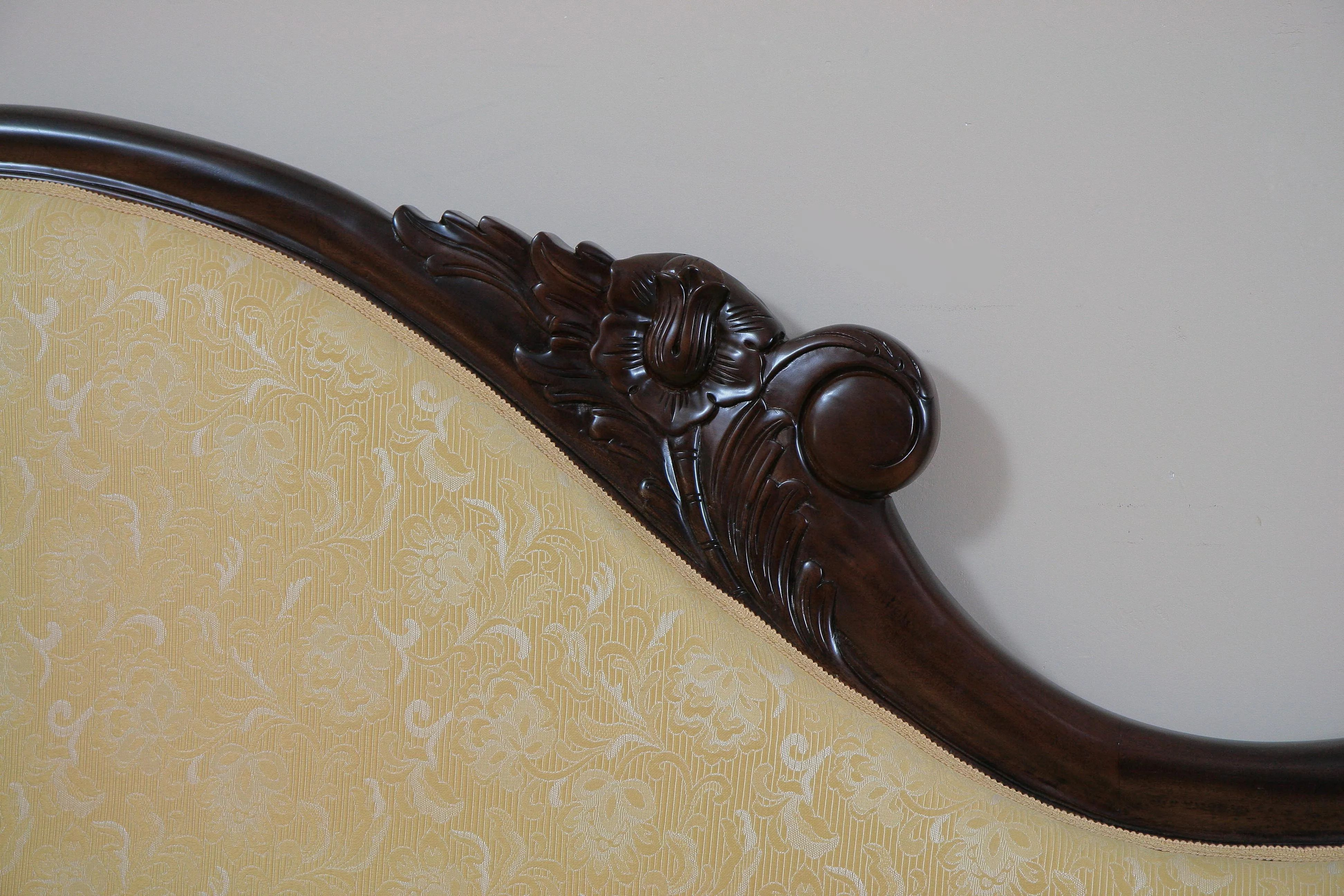 Backrest rail wood carving and upholstery edge detail